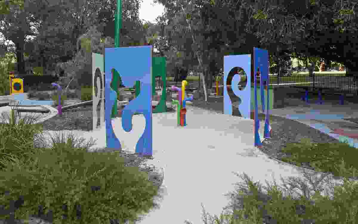 Positive and negative cut-outs enclose gathering points on either side of the playspace.