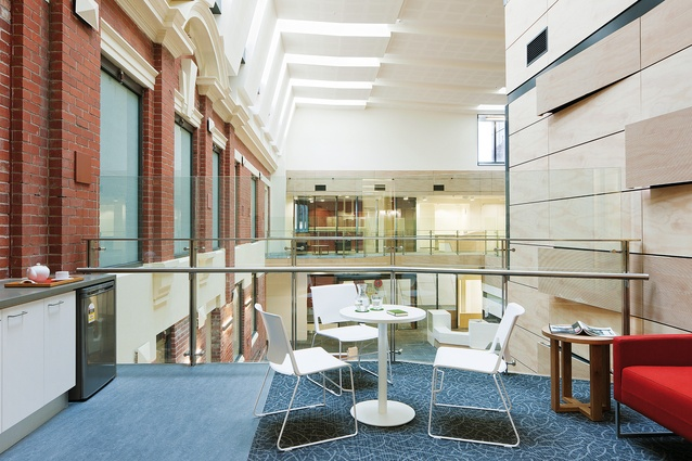 Acoustically absorbent timbers in the atrium reduce ambient noise.