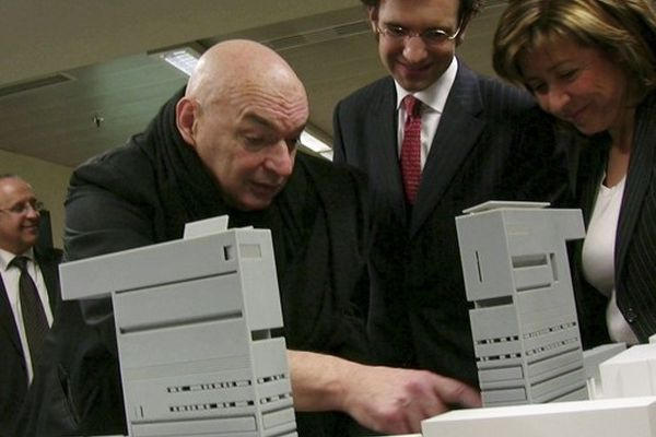 A scene from The Compeitition  where Jean Nouvel reveals his model to the Andorran minister of culture.