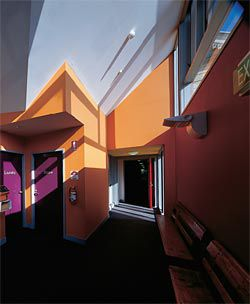 An interior circulation space showing the vibrant use of colour.