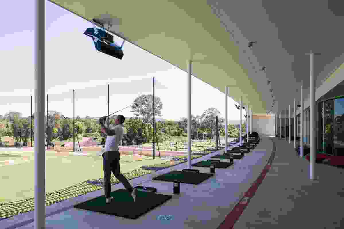 """Forty sheltered golf driving bays are housed within the main building's """"necessarily curved"""" south-western facade."""
