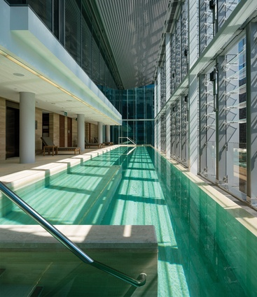 The hotel's naturally ventilated swimming pool and gymnasium look out over the city from the new Annex building.