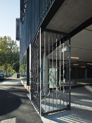 Fitzroy Apartments: An arcade of bluestone offcuts, mirrored glass and a vaulted limed ply ceiling.