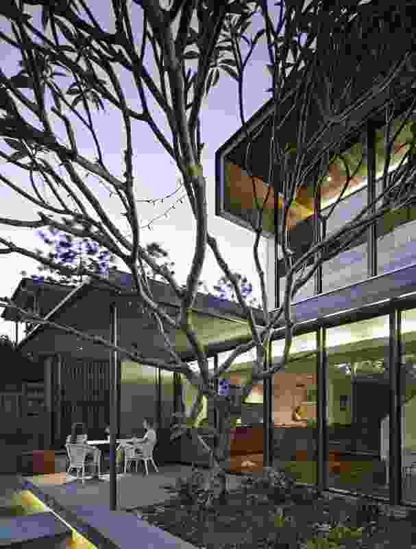 The design extends the main living area into the subtropical garden surrounds.