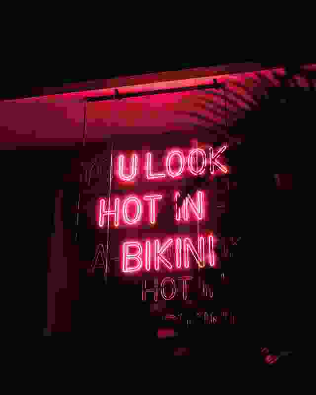 "The ""A"" in Bikini's pink neon sign flickers in out of view, inviting different readings."