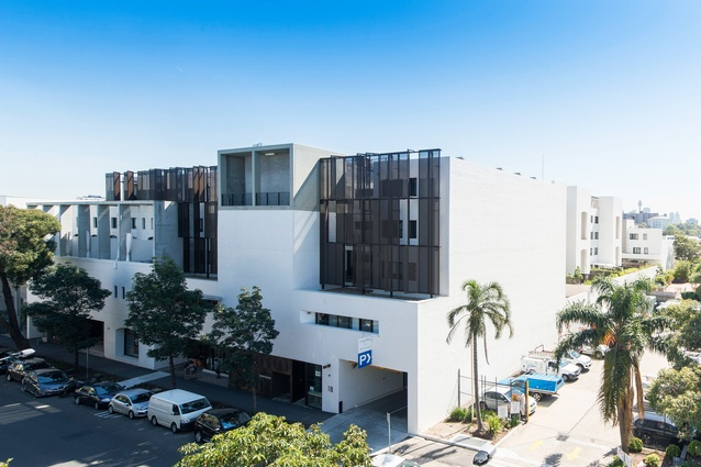"""In comparison to the northern facade of the building with its undulating horizontal lines, the southern end is """"taller and tougher,"""" in keeping with the larger scale of the surrounding apartments and warehouses."""
