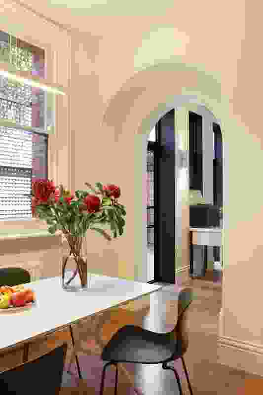 An arched doorway separates the kitchen's social and working spaces.
