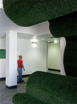 "Landscape or giant animal,       Undulant  's shaggy green folds represent ""Nature"" within the restrained space of the waiting room."