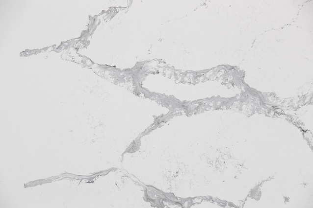 Calacatta Classic – stronger, larger-scale light grey veins on a white base.