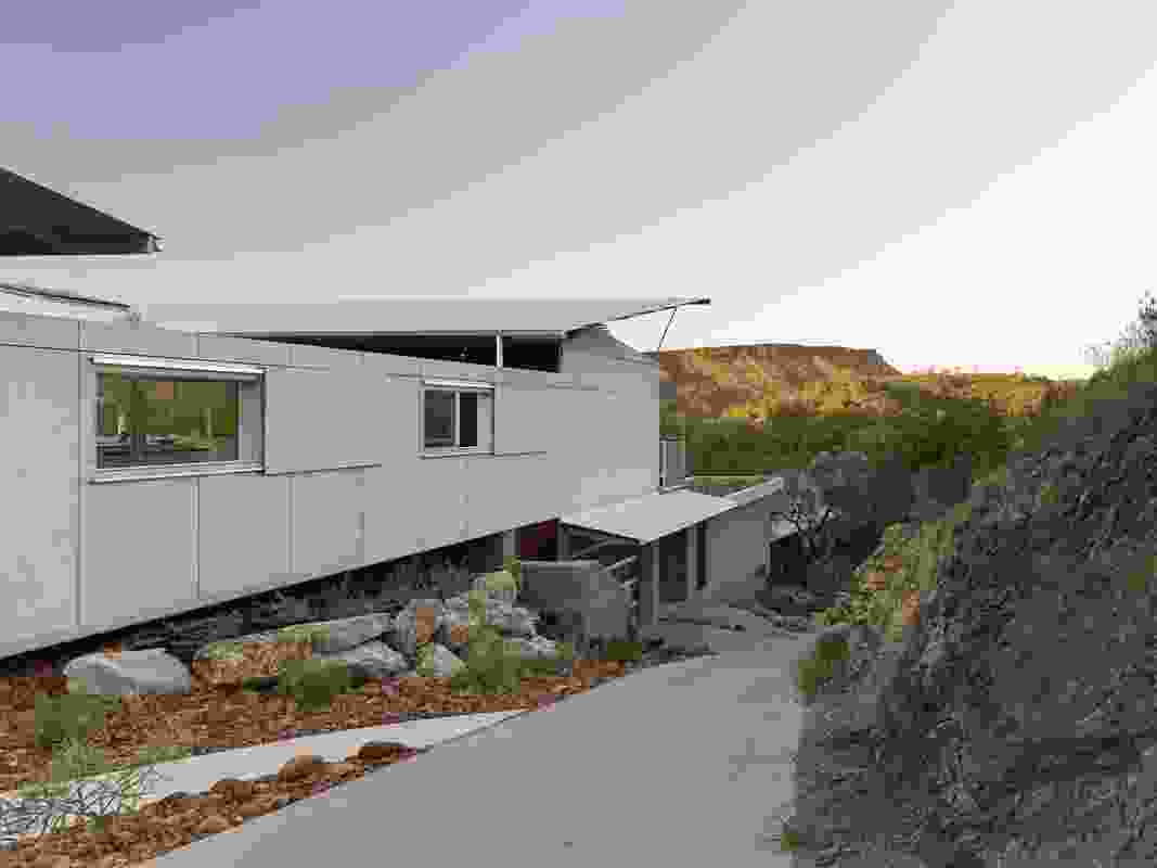 The roof of the house is set to ensure that its cupped form is alway deferent to the ranges when visible from the walking tracks on the surrounding hills.