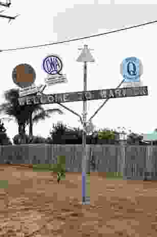 In Warwick, Queensland, a rickety crucifix sprouts the shields of the town's service clubs: Rotary, the Country Women's Association, Lions, Apex, Quota International.