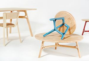 Justin Hutchinson Flow tables for Dessein Furniture in natural rubberwood and blue.
