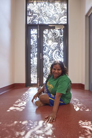 Artist Sue Bung, who contributed to the artwork of the window screens.