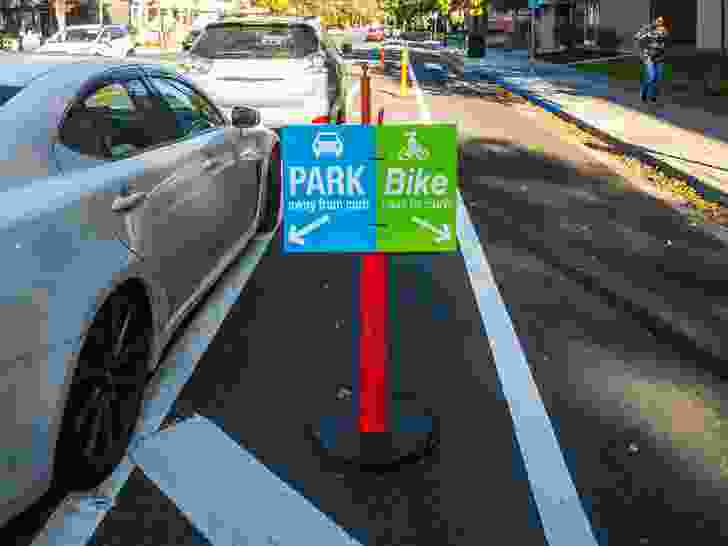 To manage the conflicting needs of car and bike users for roadside space, San Jose has created kerbside bike lanes separated from the road by car parking.