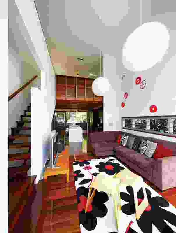 The double-height lounge room is overlooked by a mezzanine level.