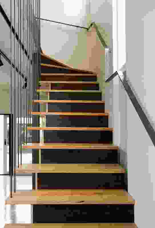 Timber stairs counter the hardness of the polished concrete floor.