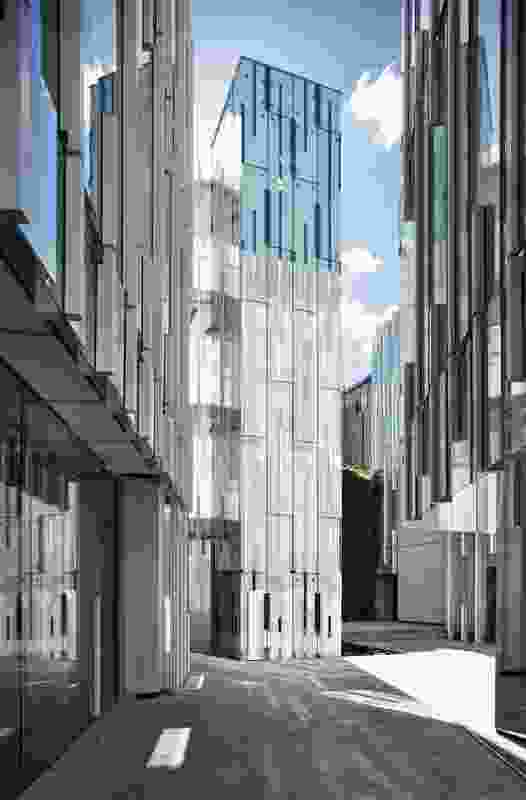 From an inner courtyard, narrow laneways veer off at different angles between the five buildings and out onto the neighbouring streets.