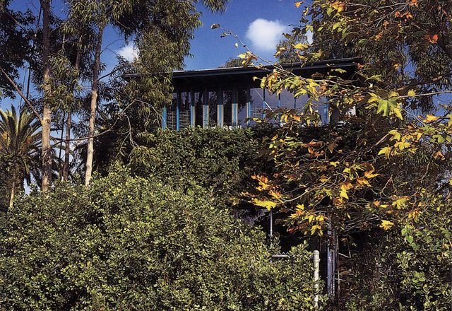 Hank and Julie's own home, 25th Street House in Santa Monica, California, features many moving parts that open it up to the outside. Obscured by landscape, the house only offers glimpses of itself.