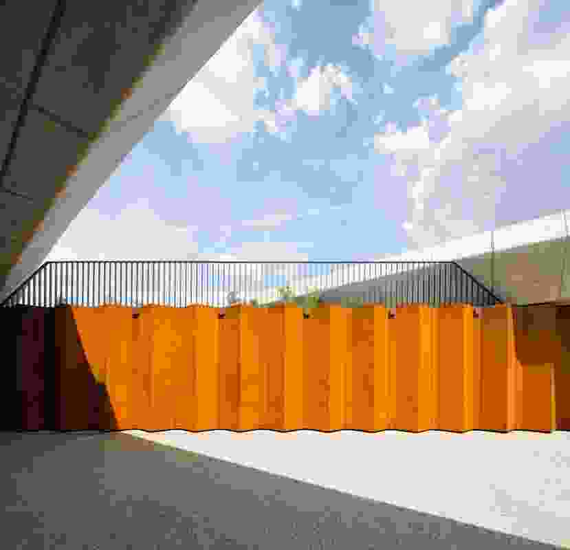 A folded Corten steel wall provides visual interest and colour to the pedestrian underpass.