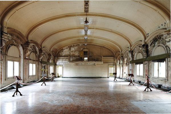 Despite the decay, the architecture of the ballroom still speaks volumes of what was once a hub of social and cultural activity.