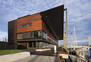 Clad in recycled Ironbark and Tallowood, the exterior and the library complements the decking of reclaimed timber from the wharf.