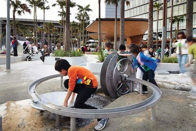 A water wheel allows kids to control the routing of water.