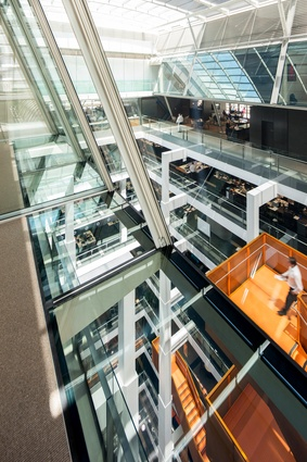 The floor plates, open atrium and structural grid of the original building have been adapted for the main workspaces of Macquarie Group's corporate headquarters.