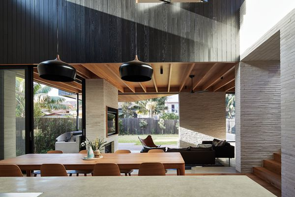 A layering of indoor and outdoor spaces defines the spatial arrangement of this coastal Sydney home.