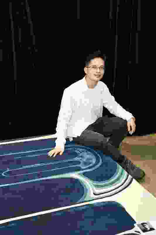 Christian Burgos with his Cavern rug, winner of the Evolve Emerge award for emerging designers.