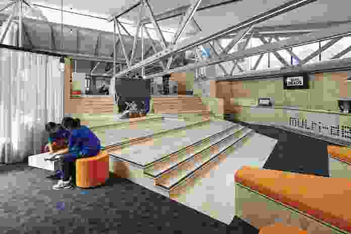"""Located adjacent to the Multi-Desk, """"the Spanish Steps"""" is a series of platforms that provide impromptu spaces for discussion, meeting and reading."""
