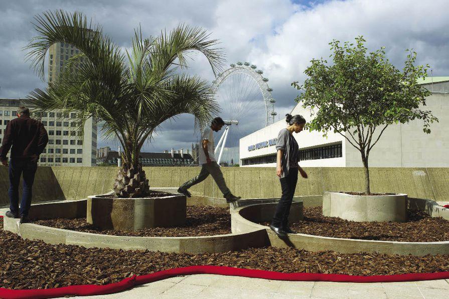 Visitors balance on  an undulating path.