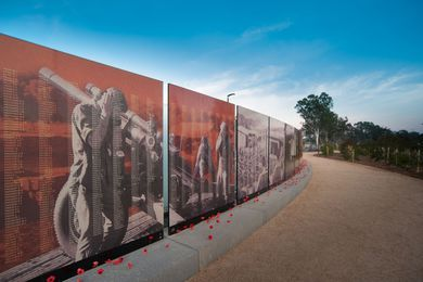 Visitors can leave poppies at the wall in remembrance.
