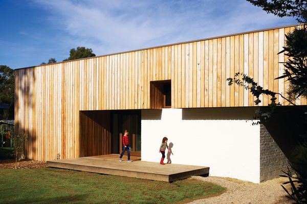 The house plays with scale, appearing to have two levels.