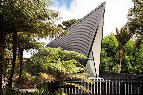 The holiday home looks something like an oversized pup tent surrounded by ferns and palms.