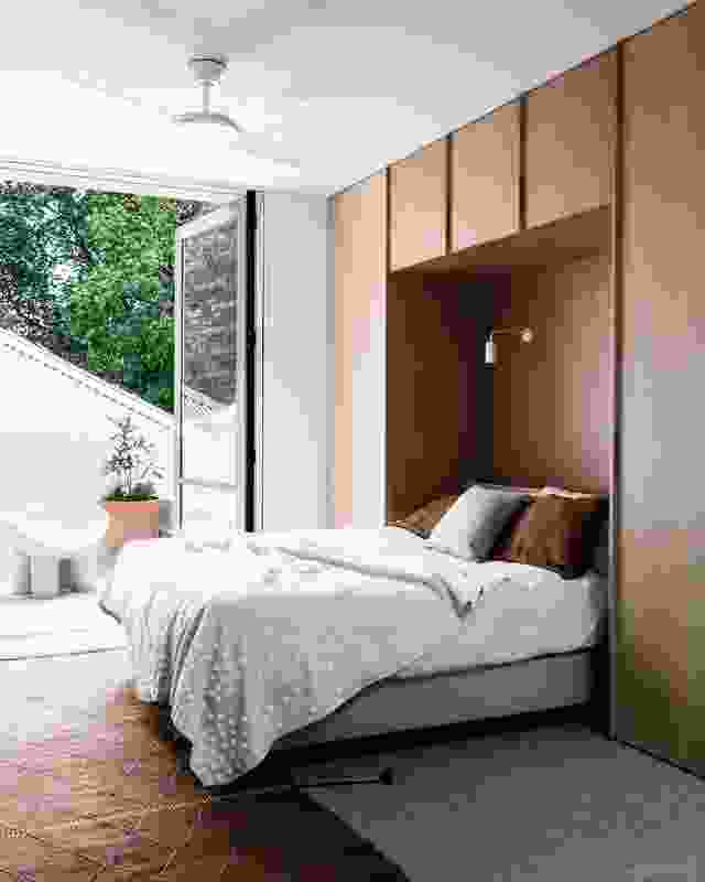 Off the main bedroom, a north-facing terrace is slung between the home's new and existing built forms.