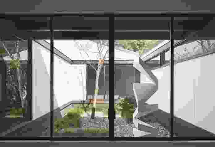 One of three courtyards, this pebble-filled area features a contemporary sculpture and has a distinctly Japanese air. Sculpture: Daniel Templeman.
