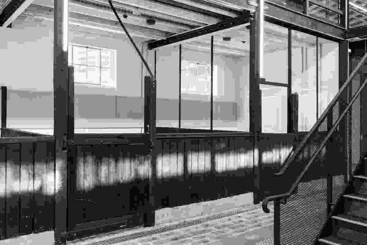 "A ""heritage slice"" preserves the original floors and stall fronts in the centre of the stables wing, now used for offices and meeting spaces."