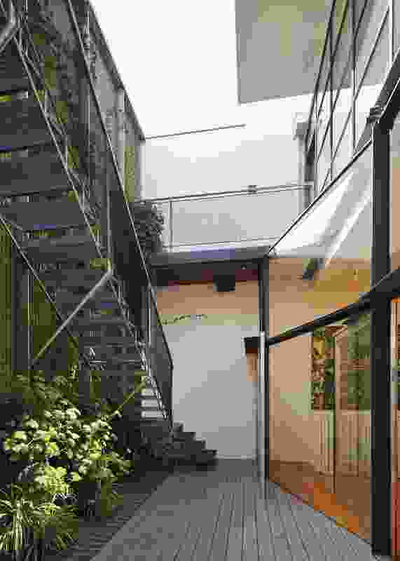 The window wall facing the courtyard forms a zigzag in plan and is roofed in glass where it pops forward of the existing facade line. Artwork: Paul Spencer, Drama, 2004.