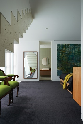 The underside of the finely detailed concrete stair is expressed in the main bedroom below.