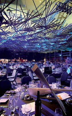 Centrepieces and handmade brooches continued the theme of the ceiling installation.