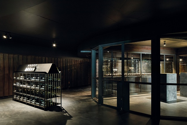 The museum features a narrative wine display, encased behind glazing and illuminated with linear strip lighting.
