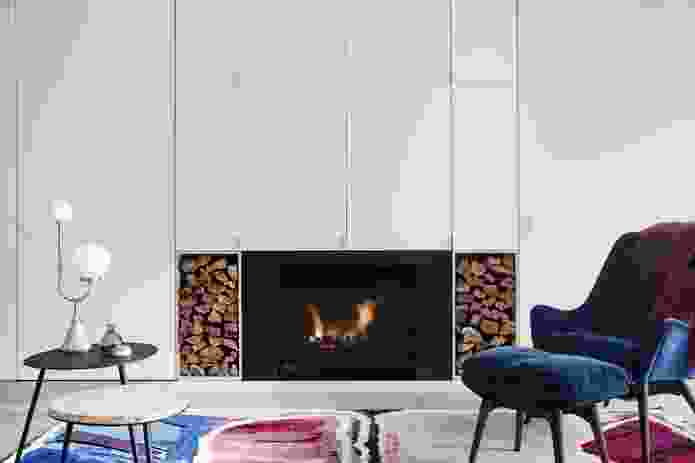A fireplace and hydronic heating provide warmth in winter, in a house that enjoys minimal temperature fluctuations.