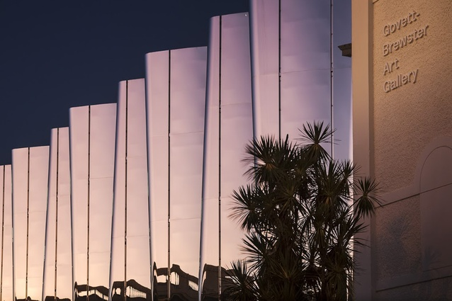 The Len Lye Centre gleams in the twilight.