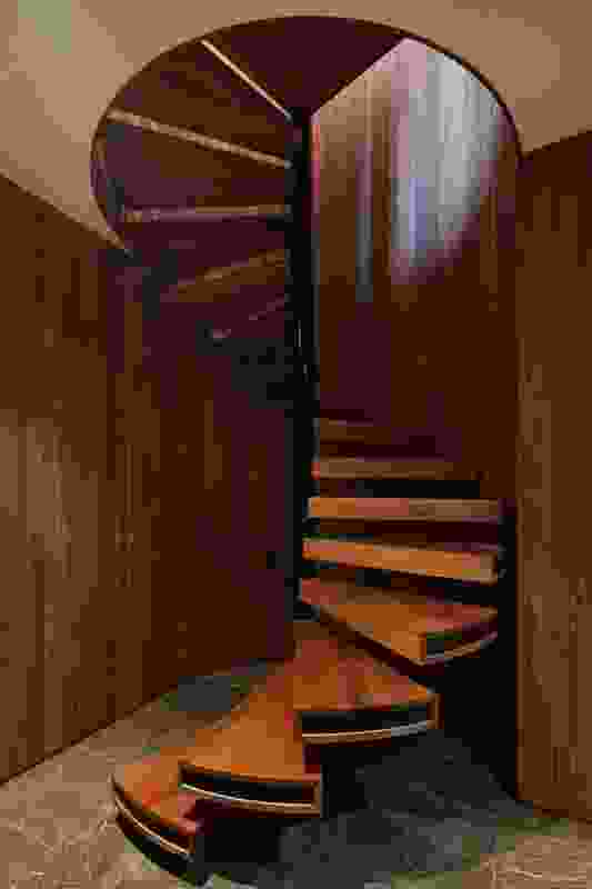 The barrel-like spiral stair leads down to a cellar and wine-tasting room.