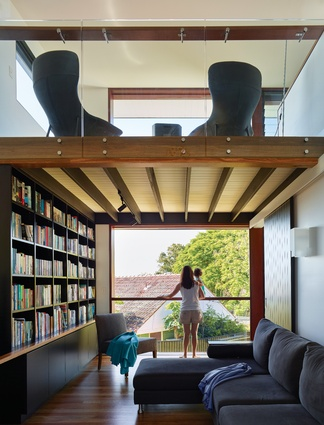 The study/library benefits from a full-height window, while the reading nook above offers a second place for quiet contemplation.