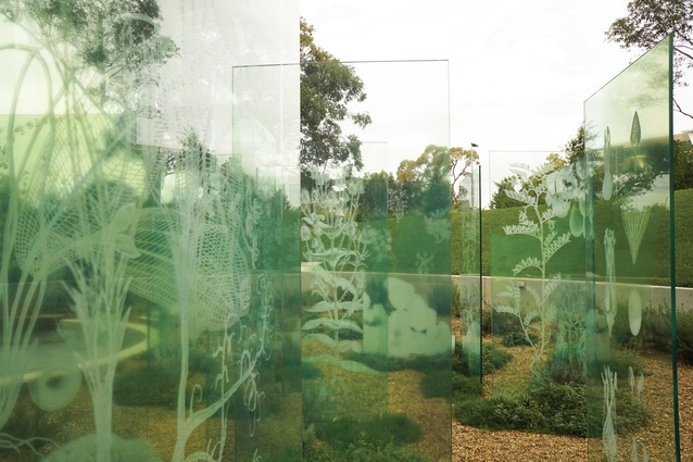 a formal grid of glass panels acts as both veils and screens in the garden - Glass Garden