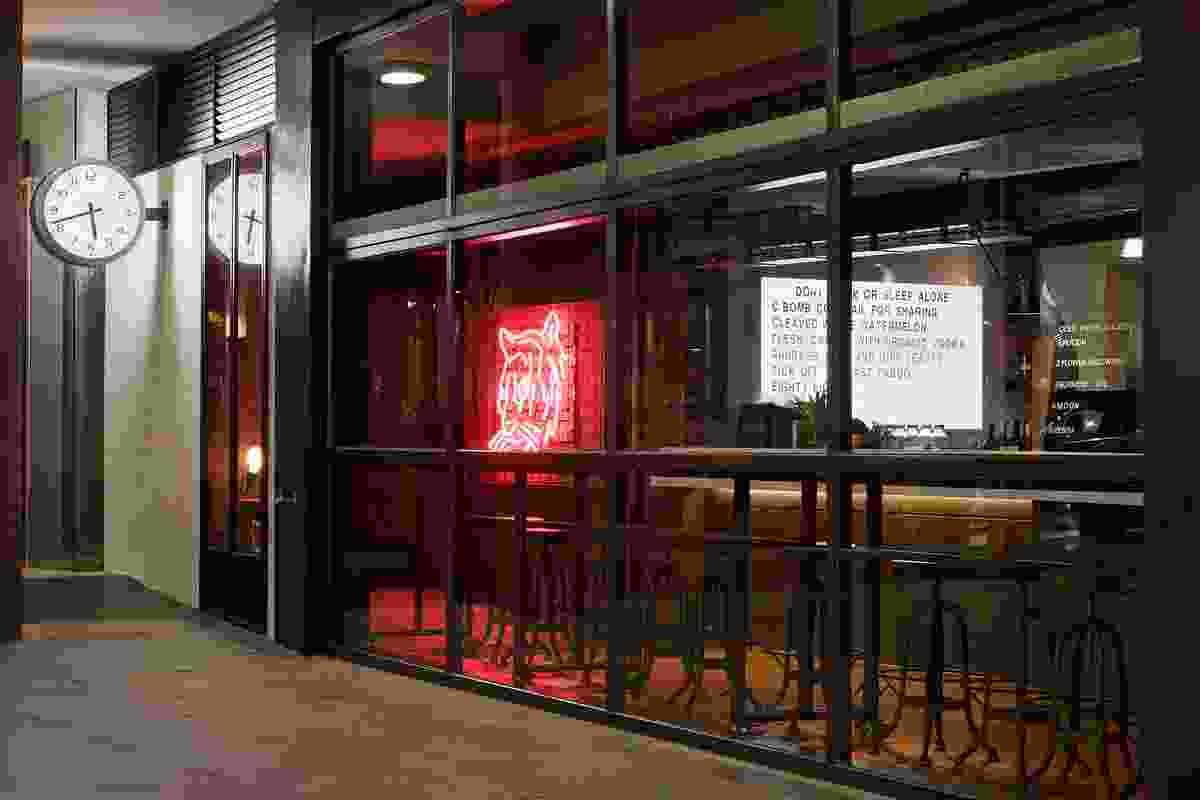 Neon sign at the corner restaurant entrance.