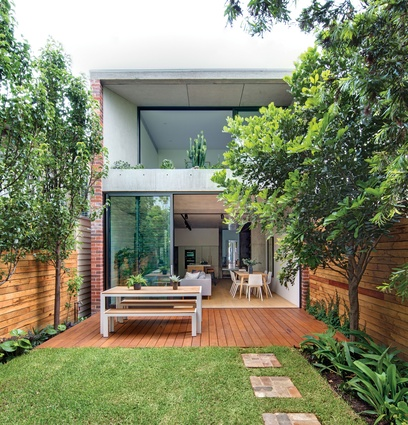 The rear addition is constructed from expressed off-form concrete and reaches into the garden.
