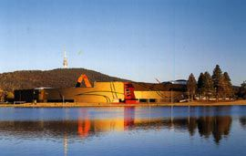 Two views of the complex in its broader landcape setting, across Lake Burley Griffin, with Black Mountain beyond.