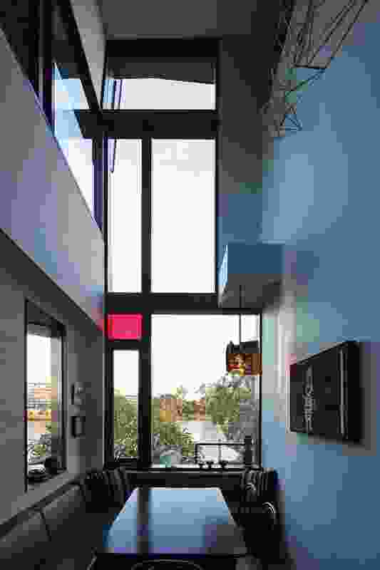 The breakfast nook is a striking double- height space. Artwork: Dion Horstmans (wall sculpture); Arthur Koo'ekka Pambegan Jr. (painting).